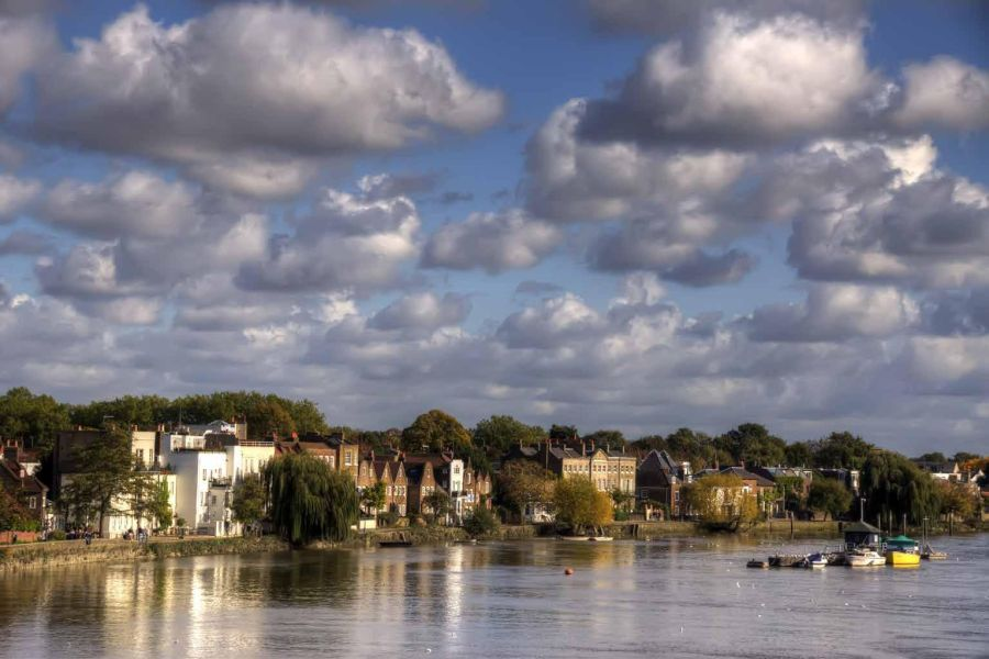 landscape of clouds, water, and houses